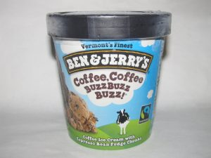 Pint of 'Coffee, Coffee, BuzzBuzzBuzz' icecream by Ben and Jerry's unopened and sitting on a white table.